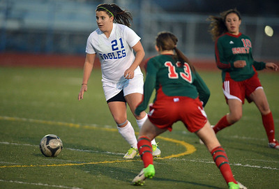 Kerri Marquardt, Broomfield moves the ball past Brynell Yount, Smoky Hill during Thursday's game at Elizabeth Kennedy Stadium. March 7, 2013 staff photo/ David R. Jennings