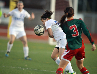 Kerri Marquardt, Broomfield blocks a kick by Natalie Rey, Smoky Hill during Thursday's game at Elizabeth Kennedy Stadium. March 7, 2013 staff photo/ David R. Jennings