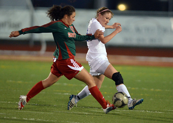 Lauren Snyder, Broomfield fights for control of the ball against Yessi Cardenas, Smoky Hill during Thursday's game at Elizabeth Kennedy Stadium.<br /> March 7, 2013<br /> staff photo/ David R. Jennings