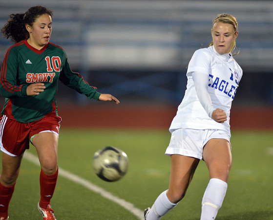 Hailey Mazzola, Broomfield kicks the ball past Yessi Cardenas, Smoky Hill during Thursday's game at Elizabeth Kennedy Stadium.<br /> March 7, 2013<br /> staff photo/ David R. Jennings