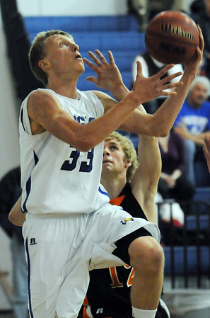 Dakota Smith, Broomfield, goes to the basket against Bobby Lebsock, Sterling during Tuesday's game at Broomfield.<br /> February 3, 2010<br /> Staff photo/David R. Jennings