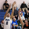 Erik Lockwood, Broomfield, shoots the ball past Brent Avila, Sterling, during Tuesday's game at Broomfield.<br /> February 3, 2010<br /> Staff photo/David R. Jennings