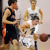 Austin Wood, Broomfield, drives the ball past Aaron Reyes, Sterling, during Tuesday's game at Broomfield.<br /> February 3, 2010<br /> Staff photo/David R. Jennings