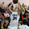 Nick Halliday, Broomfield, goes to the basket aganst Bobby Lebsock, Sterling, during Tuesday's game at Broomfield.<br /> February 3, 2010<br /> Staff photo/David R. Jennings