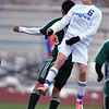 Broomfield's Porter Milner fights does a header against Summit's Alex Roque during Thursday's game at Elizabeth Kennedy Stadium.<br /> October 25, 2012<br /> staff photo/ David R. Jennings
