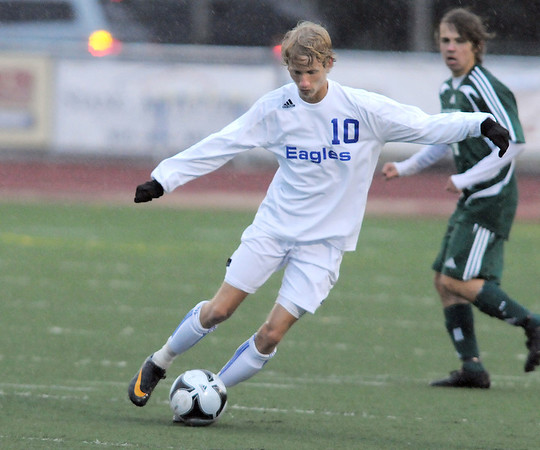 Broomfield's Tim Ayers dribbles the ball downfield against Summit during the first round of the state 4A playoffs at Elizabeth Kennedy Stadium on Tuesday.<br /> October 25, 2011<br /> staff photo/ David R. Jennings