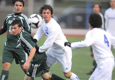 Broomfield's Fernando Cabrera move the ball to Noah Chapleski past Summit's Evan Feldman during the first round of the state 4A playoffs at Elizabeth Kennedy Stadium on Tuesday. October 25, 2011 staff photo/ David R. Jennings