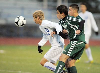 Broomfield's Tim Ayers fights for control of the ball with Summit's Mamadou Maguiraga during the first round of the state 4A playoffs at Elizabeth Kennedy Stadium on Tuesday. October 25, 2011 staff photo/ David R. Jennings