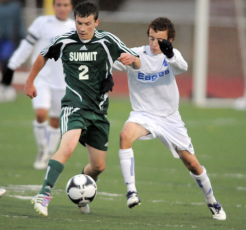 Broomfield's Noah Chapleski fights for control of the ball with Summit's Evan Feldman during the first round of the state 4A playoffs at Elizabeth Kennedy Stadium on Tuesday.<br /> October 25, 2011<br /> staff photo/ David R. Jennings