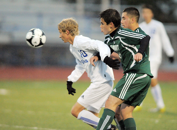 Broomfield's Tim Ayers fights for control of the ball with Summit's Mamadou Maguiraga during the first round of the state 4A playoffs at Elizabeth Kennedy Stadium on Tuesday.<br /> October 25, 2011<br /> staff photo/ David R. Jennings