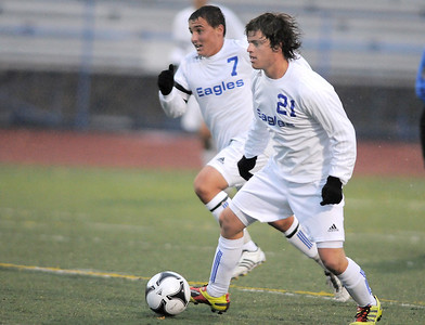 Broomfield's Fernando Cabrera dribbles the ball downfield against Summit during the first round of the state 4A playoffs at Elizabeth Kennedy Stadium on Tuesday. October 25, 2011 staff photo/ David R. Jennings