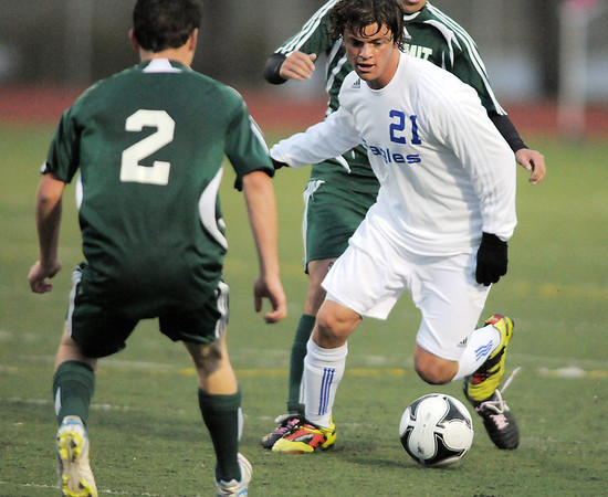 Broomfield's Fernando Cabrera dribbles the ball downfield against Summit's Evan Feldman during the first round of the state 4A playoffs at Elizabeth Kennedy Stadium on Tuesday.<br /> October 25, 2011<br /> staff photo/ David R. Jennings