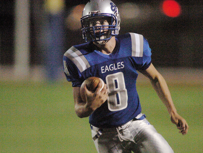 Quarterback Aric Kaiser, Broomfield, carries the ball to the endzone for a touchdown against Thompson Valley during Friday's game at Elizabeth Kennedy Stadium.<br /> <br /> October 15, 2010<br /> staff photo/David R. Jennings