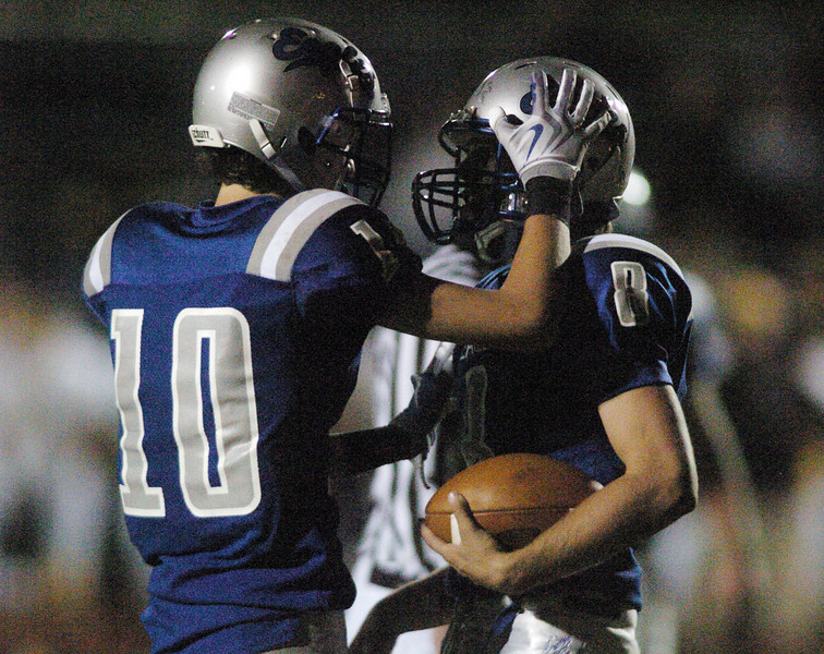 Broomfield quarterback Aric Kaiser, right, is congratulated by Nick Ongarato after making a touchdown against Thompson Valley  during Friday's game at Elizabeth Kennedy Stadium.<br /> <br /> October 15, 2010<br /> staff photo/David R. Jennings