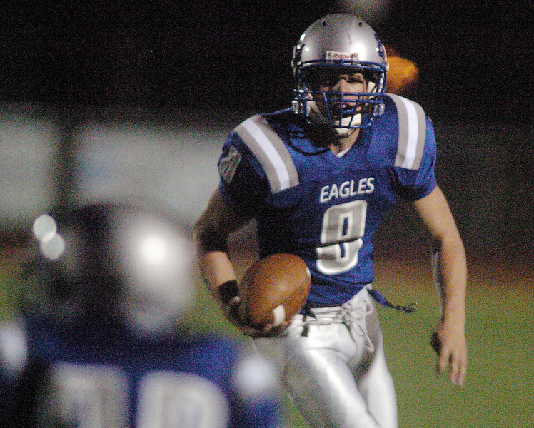 Eagle's quarterback Aric Kaiser keeps and runs the ball against Thompson Valley during Friday's game at Elizabeth Kennedy Stadium.<br /> <br /> October 15, 2010<br /> staff photo/David R. Jennings