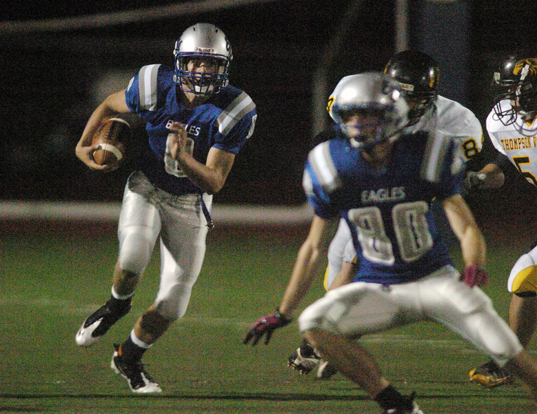 Broomfield quarterback Aric Kaiser keeps the ball to make a run against Thompson Valley during Friday's game at Elizabeth Kennedy Stadium.<br /> <br /> October 15, 2010<br /> staff photo/David R. Jennings