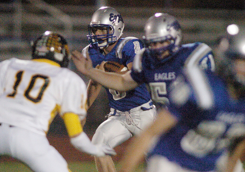 Aric Kaiser, Broomfield, carries the ball against Thompson Valley during Friday's game at Elizabeth Kennedy Stadium.<br /> <br /> October 15, 2010<br /> staff photo/David R. Jennings
