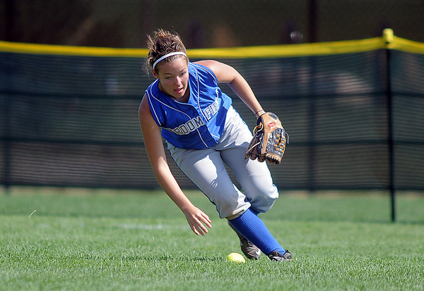 Karli Hughes, Broomfield, picks up a ball in the outfiield during Friday's game against Tuttle, Oklahoma at the Erie Festival of Champions softball tournament.<br /> <br /> September 2, 2011<br /> staff photo/ David R. Jennings