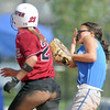 Isabelle Yamaguchi, Broomfield, reacts after being hit by the ball during Friday's game against Tuttle, Oklahoma at the Erie Festival of Champions softball tournament.<br /> <br /> September 2, 2011<br /> staff photo/ David R. Jennings