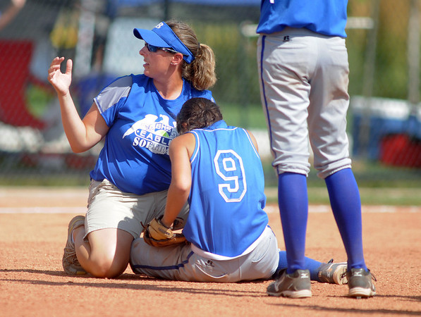 Coach Paula Seifried looks after Isabelle Yamaguchi, Broomfield, after being hit by the ball during Friday's game against Tuttle, Oklahoma at the Erie Festival of Champions softball tournament.<br /> <br /> September 2, 2011<br /> staff photo/ David R. Jennings