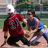 Isabelle Yamaguchi, Broomfield, misses the ball trying to tag out a Tuttle player at second base during Friday's game against Tuttle, Oklahoma at the Erie Festival of Champions softball <br /> <br /> September 2, 2011<br /> staff photo/ David R. Jennings
