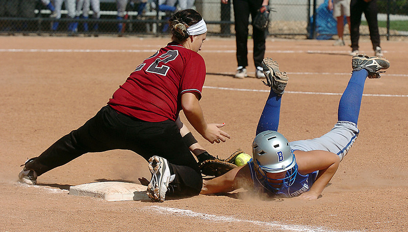Broomfield's Lindsey Shiels-Brophy safely sldes back to first base during Friday's game against Tuttle, Oklahoma at the Erie Festival of Champions softball tournament.<br /> <br /> September 2, 2011<br /> staff photo/ David R. Jennings