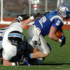 Broomfield's Dan Geubelle is tackled by Valor Christian during the semi final game on Saturday at Elizabeth Kennedy Stadium.<br /> November 27, 2010<br /> staff photo/David R. Jennings