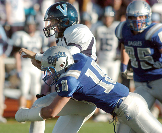 Broomfield's Hayden Underberg sacks Valor Christian's quarterback Brock Berglund during the semi final game on Saturday at Elizabeth Kennedy Stadium.<br /> November 27, 2010<br /> staff photo/David R. Jennings