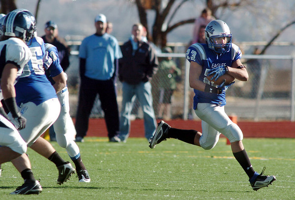 Broomfield's Jose Fraire runs the ball downfield against Valor Christian during the semi final game on Saturday at Elizabeth Kennedy Stadium.<br /> November 27, 2010<br /> staff photo/David R. Jennings