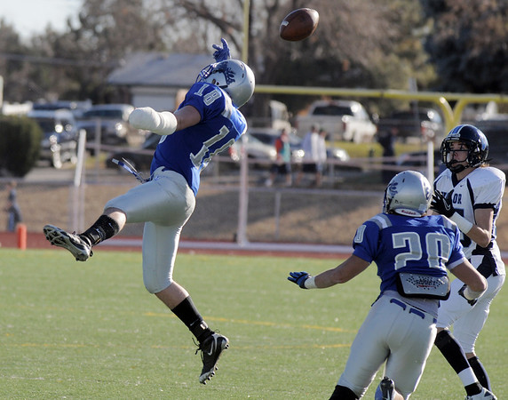 Broomfield's Hayden Underberg tries to break up a pass for Valor Christian's Stephen Miller during the semi final game on Saturday at Elizabeth Kennedy Stadium.<br /> November 27, 2010<br /> staff photo/David R. Jennings