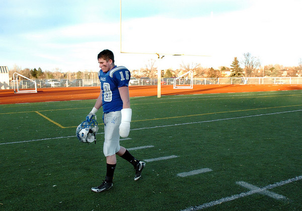 Broomfield's Hayden Underberg walks off the field after the Eagles lost to Valor Christian in the semi final game on Saturday at Elizabeth Kennedy Stadium.<br /> November 27, 2010<br /> staff photo/David R. Jennings