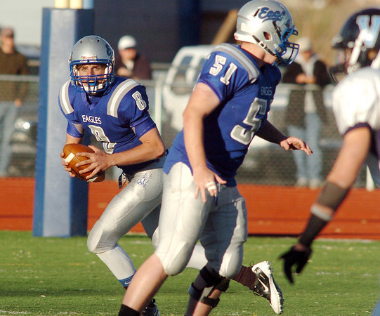 Broomfield's quarterback Aric Kaiser looks for a receiver during the semi final game against Valor Christian on Saturday at Elizabeth Kennedy Stadium.<br /> November 27, 2010<br /> staff photo/David R. Jennings