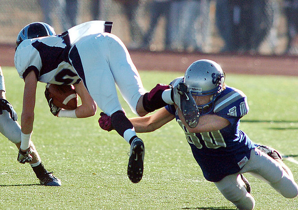 Broomfield's Zach Gorman tackles Stephen Miller, Valor Christian during the semi final game on Saturday at Elizabeth Kennedy Stadium.<br /> November 27, 2010<br /> staff photo/David R. Jennings