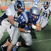 Broomfield's Sean Gentry keeps running as Valor Christian's Alex Kozan makes the tackle during the semi final game on Saturday at Elizabeth Kennedy Stadium.<br /> November 27, 2010<br /> staff photo/David R. Jennings