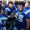 Phil Latimer right, begins to walk away after the Eagles did a last cheer after being defeated by Valor Christian in the semi final game on Saturday at Elizabeth Kennedy Stadium.<br /> November 27, 2010<br /> staff photo/David R. Jennings