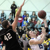 Broomfield's Evan Kihn, right, goes to the basket against Wasson's Gabe Ehrlin during Saturday's state 4A playoff game at Broomfield.<br /> February 24, 2012 <br /> staff photo/ David R. Jennings