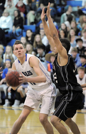 Broomfield's Spenser Reeb pauses before shooting the ball past Wasson's Abay Young during Saturday's state 4A playoff game at Broomfield.<br /> February 24, 2012 <br /> staff photo/ David R. Jennings