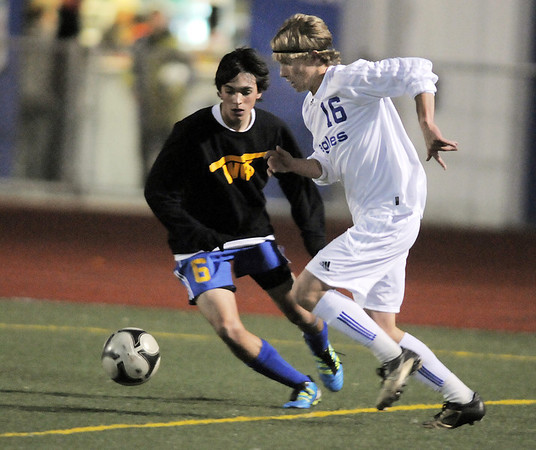 Thomas O'Brien, Broomfield takes control of the ball from Peter Wing, Wheat Ridge, during the 4A soccer quarter finals at Elizabeth Kennedy Stadium on Tuesday.<br /> November 1, 2011<br /> staff photo/ David R. Jennings