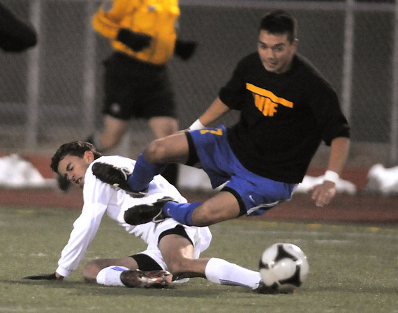 Colton Lamb, Broomfield, kicks the ball under Ben McBride, Wheat Ridge during the 4A soccer quarter finals at Elizabeth Kennedy Stadium on Tuesday.<br /> November 1, 2011<br /> staff photo/ David R. Jennings
