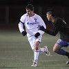 Nick Saunders,  Broomfield, fights for control of the ball with Filiberto Morales, Wheat Ridge, during the 4A soccer quarter finals at Elizabeth Kennedy Stadium on Tuesday.<br /> November 1, 2011<br /> staff photo/ David R. Jennings