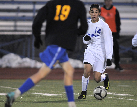 Ricardo Ocampo, Broomfield,dribbles the ball downfield against Noah Brookman, Wheat Ridge during the 4A soccer quarter finals at Elizabeth Kennedy Stadium on Tuesday.<br /> November 1, 2011<br /> staff photo/ David R. Jennings