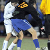 Connor Metzger, Broomfield fights for control of the ball with Noah Brookman, Wheat Ridge during the 4A soccer quarter finals at Elizabeth Kennedy Stadium on Tuesday.<br /> November 1, 2011<br /> staff photo/ David R. Jennings