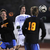 Connor Metzger, Broomfield moves the ball past Ben McBride and Chris Ridley, Wheat Ridge during the 4A soccer quarter finals at Elizabeth Kennedy Stadium on Tuesday.<br /> November 1, 2011<br /> staff photo/ David R. Jennings