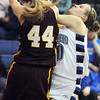 Broomfield's Bre Burgesser fights for the ball with Windsor's Sara Larson during Saturday's game at Broomfield.<br /> January 16, 2010<br /> Staff photo/David R. Jennings