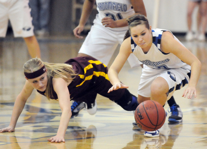 Broomfield's Millie Reeves, right, scrambles for loose ball against Windsor's Sara Larson during Saturday's game at Broomfield.<br /> January 16, 2010<br /> Staff photo/David R. Jennings