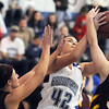 Broomfield's Renae Waters  fights to get to the basket with Windsor's Evanee Pearcey and Kellie Ash during Saturday's game at Broomfield.<br /> January 16, 2010<br /> Staff photo/David R. Jennings
