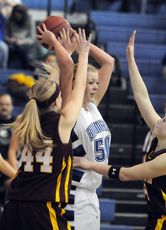 Broomfield's Bre Burgesser rebounds the ball against Windsor's Sara Larson during Saturday's game at Broomfield.<br /> January 16, 2010<br /> Staff photo/David R. Jennings