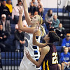 Broomfield's Bre Burgesser goes up for two against  Windsor's Stephanie Clark during Saturday's game at Broomfield.<br /> January 16, 2010<br /> Staff photo/David R. Jennings