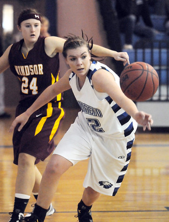 Broomfield's Renae Waters goes to the ball past Windsor's Evanee Pearcey during Saturday's game at Broomfield.<br /> January 16, 2010<br /> Staff photo/David R. Jennings