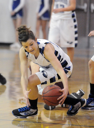 Broomfield's Katie Nehf grabs a loose ball during Saturday's game against Windsor at Broomfield.<br /> January 16, 2010<br /> Staff photo/David R. Jennings